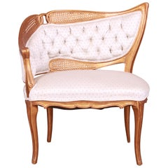 French Rococo Louis XV Giltwood and Cane Upholstered Fireside Chair