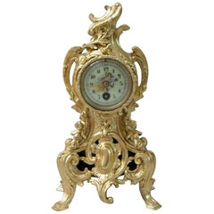 French Rococo Style Gilt Metal Mantel Clock by Harris and Harrington
