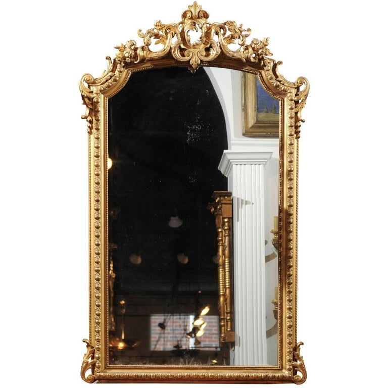French Rococo Style Giltwood Mirror with Cartouche Carved Crest, 19th Century For Sale
