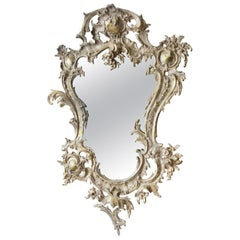 French Rococo Style Relief Cast Brass and Antiqued Cartouche Shaped Wall Mirror