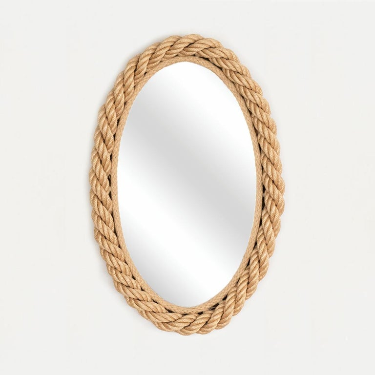 Oval wall mirror with light twisted rope frame. By Adrien Audoux and Frida Minet from France, 1940's.