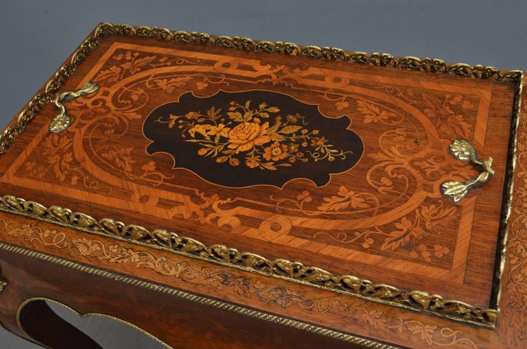 Sn4349 stylish rosewood jardinière, having original brass gallery to the top and lift up centre above finely inlaid shaped frieze, all standing on inlaid cabriole legs terminating in brass sabots. This antique plant Stand is ormolu decorated