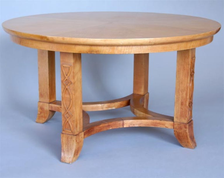 Round French coffee table or side table in the style of Andre Arbus. Sycamore veneer sun burst decorative top and with solid Sycamore legs with applied decorative motifs to the legs.