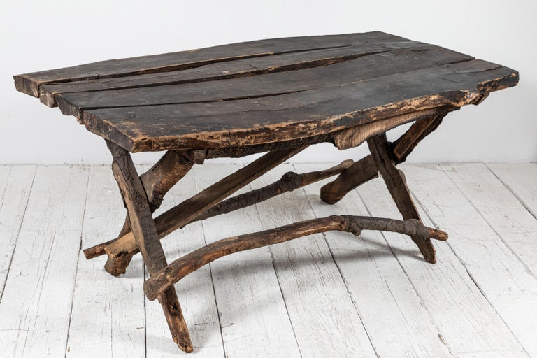 French rustic wooden table with unique twig details.