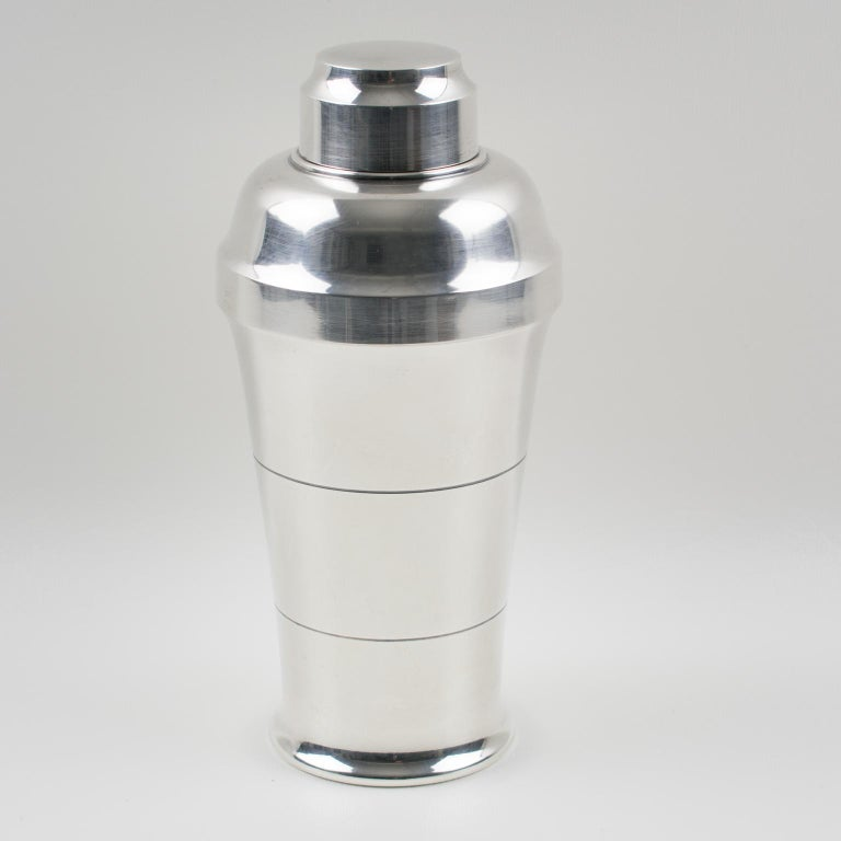 Elegant French Art Deco silver plate cylindrical cocktail or Martini Shaker by silversmith Saint Medard, Paris. Three sectioned designed cocktail Shaker with removable CAP and strainer. Lovely Art Deco design with geometric design. Marked underside: