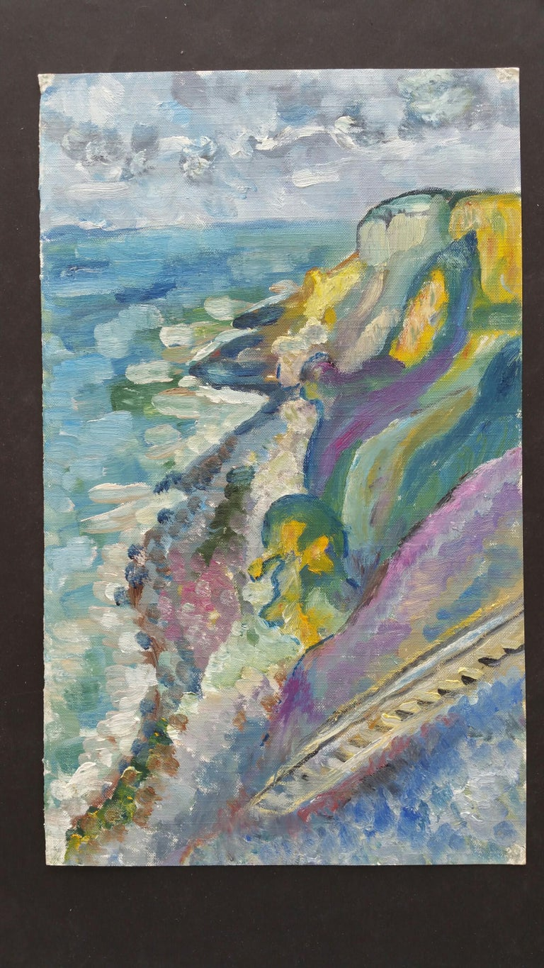 Rocky Coastline French School, mid-late 20th century unsigned oil painting on canvas textured paper (reverse side is smooth, the painted side looks and feels as canvas), unframed overall 15 x 9 inches  Vibrant oil painting depicting a view from the
