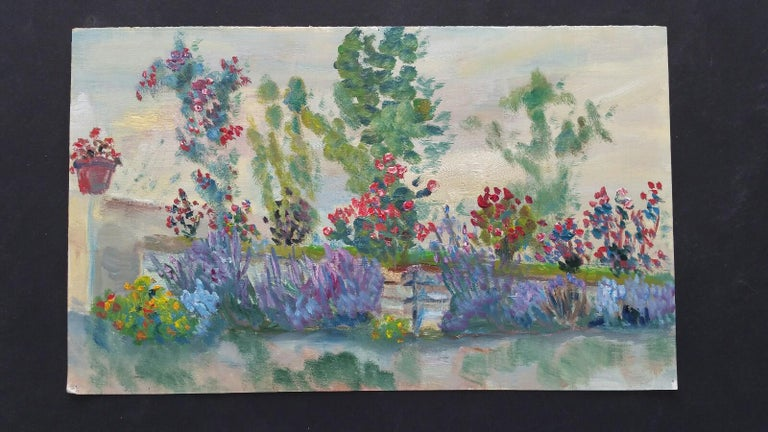 Summer Garden Border French School, mid-late 20th century unsigned oil painting on canvas textured paper (reverse side is smooth, the painted side looks and feels as canvas), unframed overall 9 x 15 inches  Lavender, roses and a terracotta pot of,