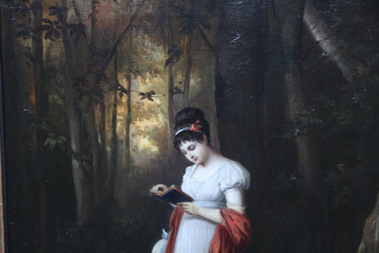 This charming early 19th century oil painting is from the French School. It is signed with a monogram in red lower right. Painted in a realistic but romantic manner with detailed brushwork, the young woman is illuminated as if in a ray of light. The