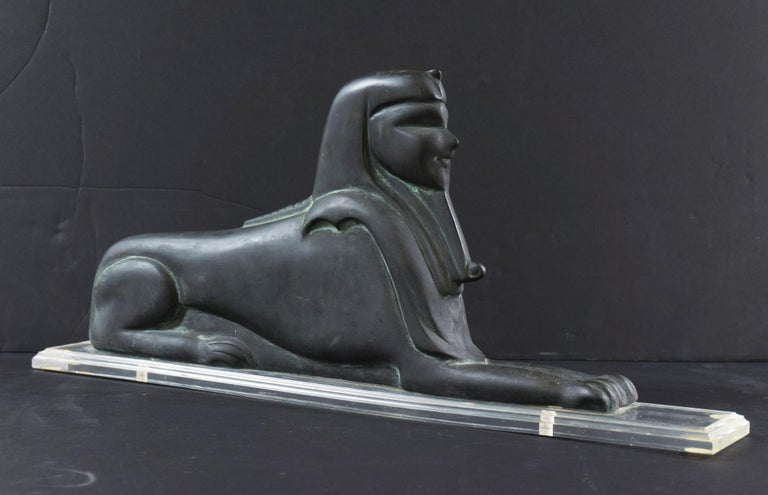 A substantial, lost wax, Bronze sculpture of a sphinx, sculpted in the Art Deco style, and of the period, now mounted on a stepped, clear acrylic base. A commanding piece with excellent and original patination created circa 1930.  Base dimensions: