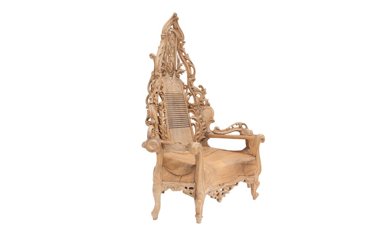 Sculptural hand carved wooden throne or lounge chair, impressive in design and size.