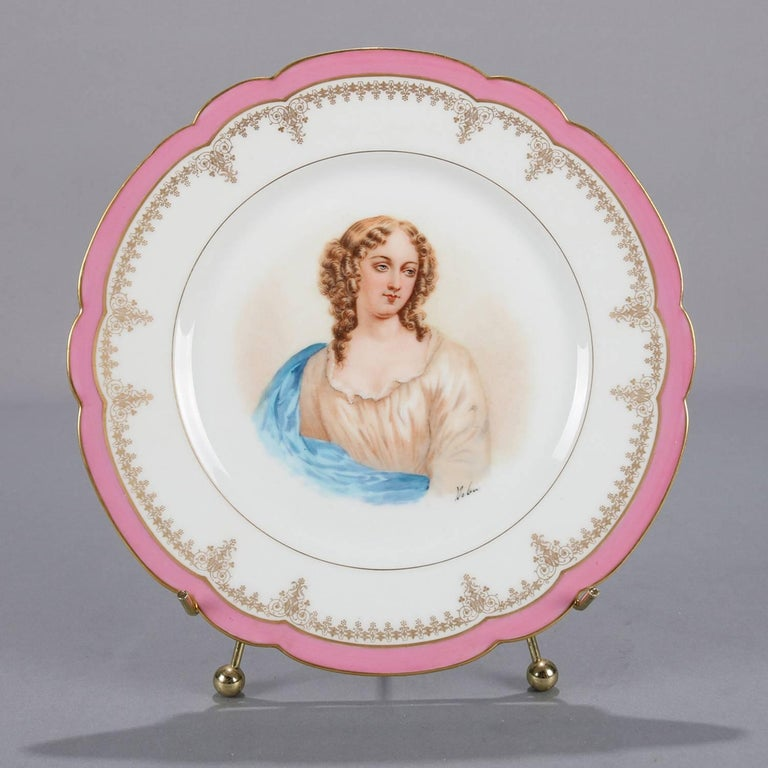 Antique French portrait plate by Sevres for Chateau de St Cloud features well with central artist signed portrait of Madame de Pavalliere by Debrie, rim with gilt scalloped edges and decorated with rose pink and gilt foliate motif, en verso stamped