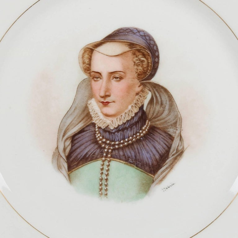 Antique French porcelain portrait plate by Sevres for Chateau de St cloud features well with central artist signed portrait of Jeanne D'Albret by Debrie and framed with gilt repeating and stylized fleur de lis pattern, rim with gilt scalloped edges