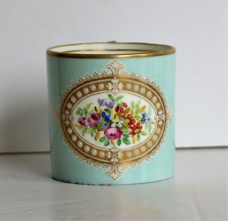 This is a very beautiful jewelled coffee can all hand painted and gilded in the French Sevres style, possibly made by them and dating to the early 19th century, circa 1810.