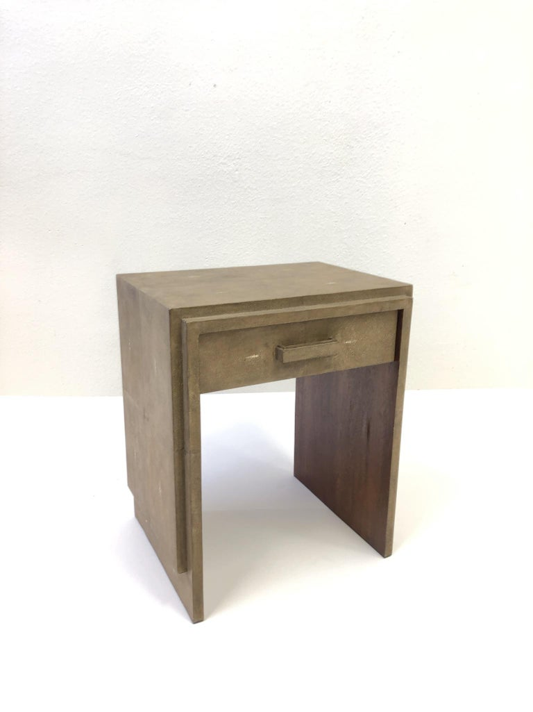 """A glamorous, 1990s French shagreen and mahogany veneer side table design by Ria and Yiouri Augousti. The table has a drawer.  Dimensions: 23.75"""" high 19.75"""" wide 15.75"""" deep."""