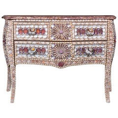 A French Shell Inlaid Serpentine Fronted Bombe Commode in the Louis XV Style