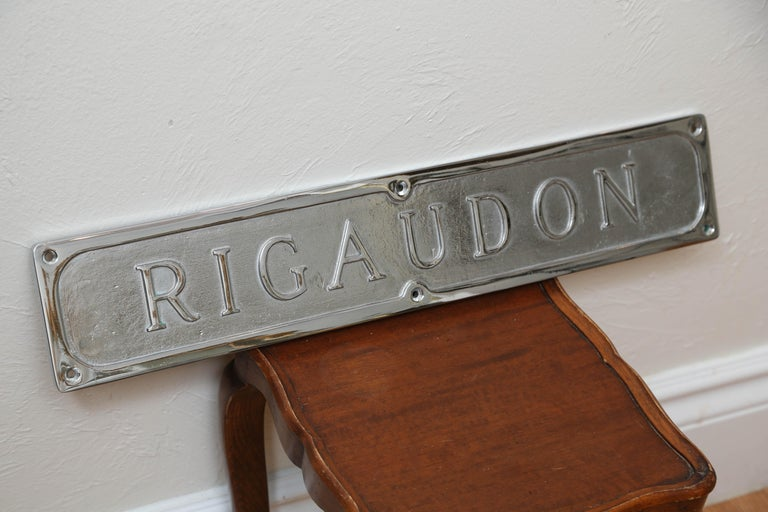 Rigaudon plated sign which means lively dance. Comes from the French, 17th century Baroque folk dance.
