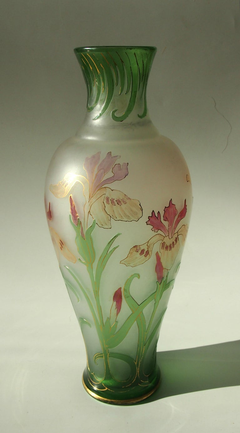 Superb early French Art Nouveau green over clear cameo, gilded and enamel glass vase by Cristallerie De Pantin depicting Irises. The green layer is cameo the pink flowers are enameled. This is an exceptionally early French Cameo circa 1889. Nicely