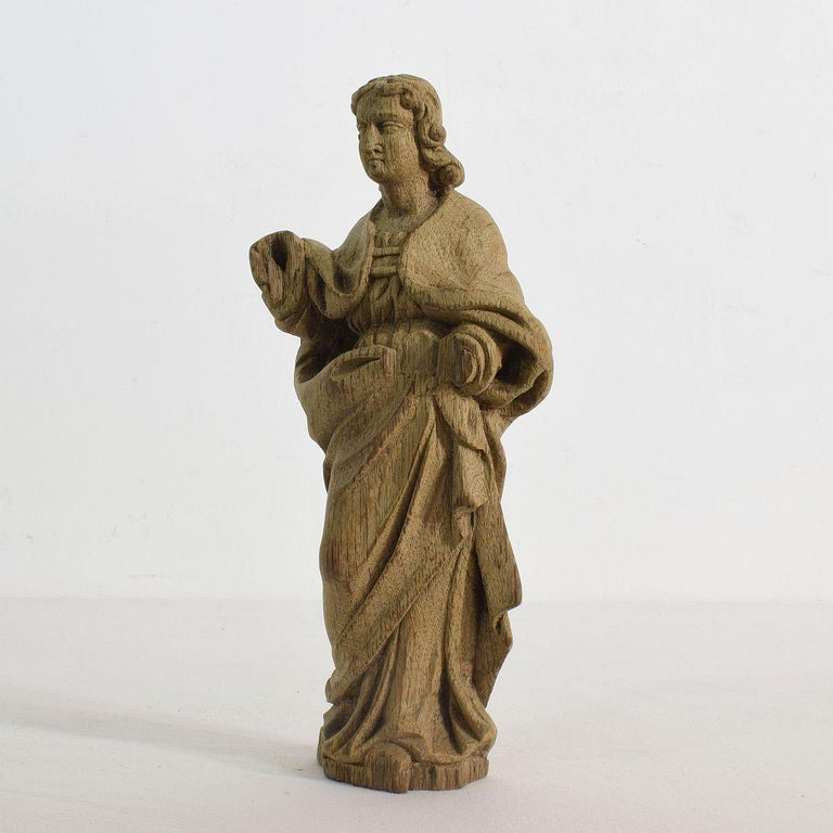Beautiful weathered small oak saint statue, France, 18th century. Weathered and small losses.