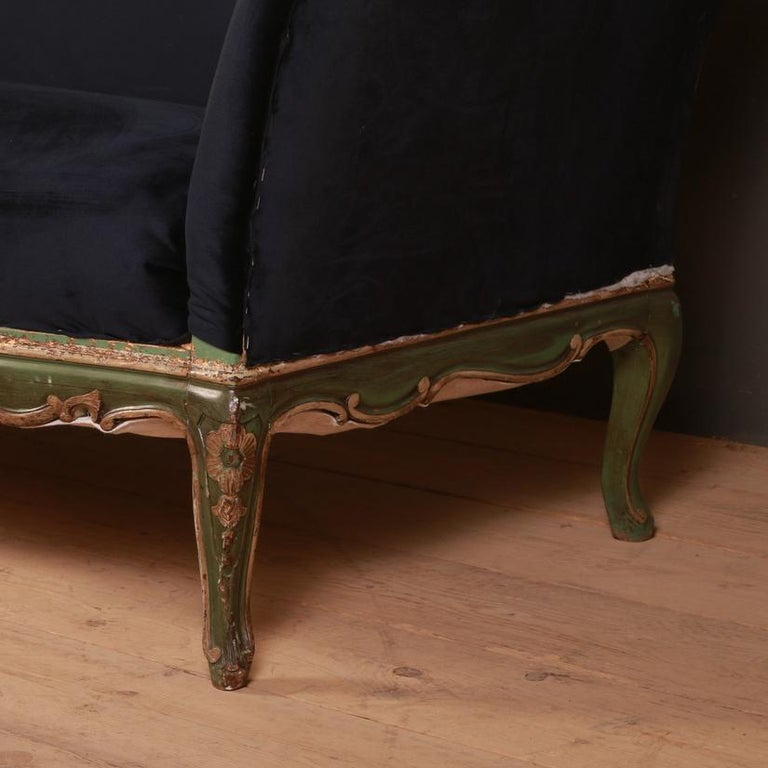 Pretty 19th century French carved and painted sofa upholstered in blue velvet, 1880 Seat height 18