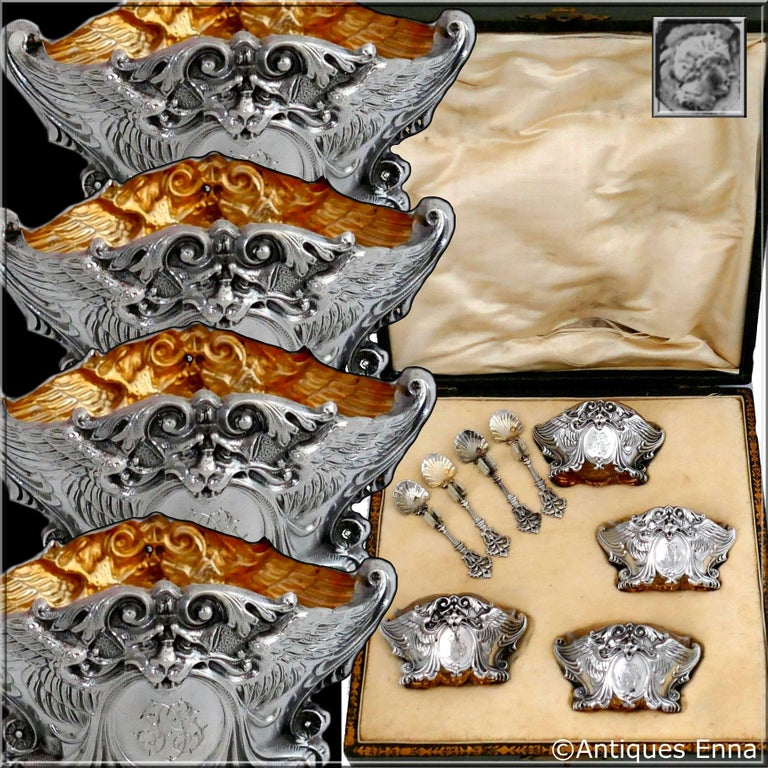Head of Minerve first titre for 950/1000 French sterling silver vermeil guarantee. The quality of the gold used to recover sterling silver is a minimum of 750 mils (18K).  Fabulous French sterling silver salt cellars four-pieces. Each ornately