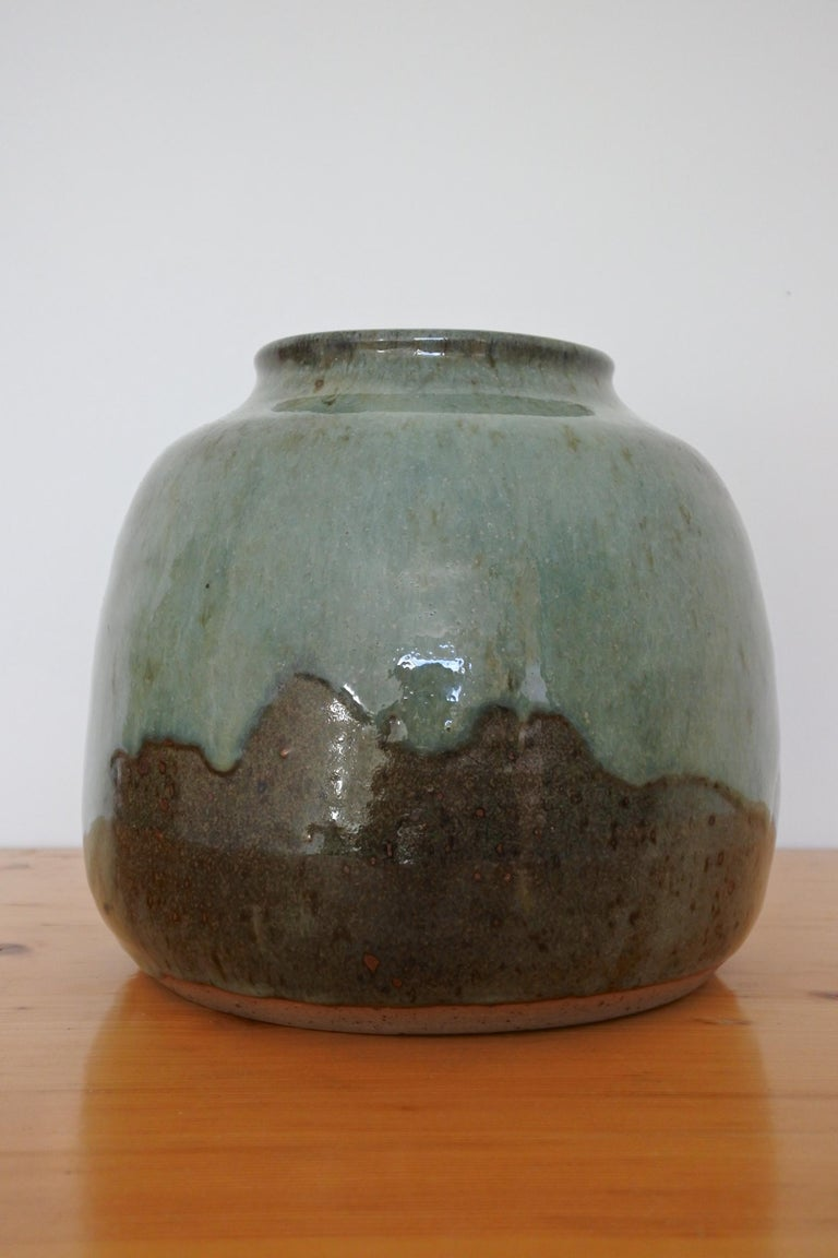 Stoneware vase from renowned pottery center La Borne in France. 1970s. Outstanding dripping glaze. Signed.