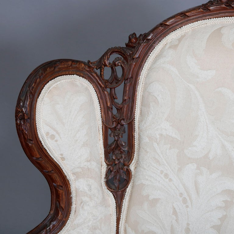 Louis XV French Style Carved Mahogany Upholstered Wingback Fireside Chair, 20th Century For Sale
