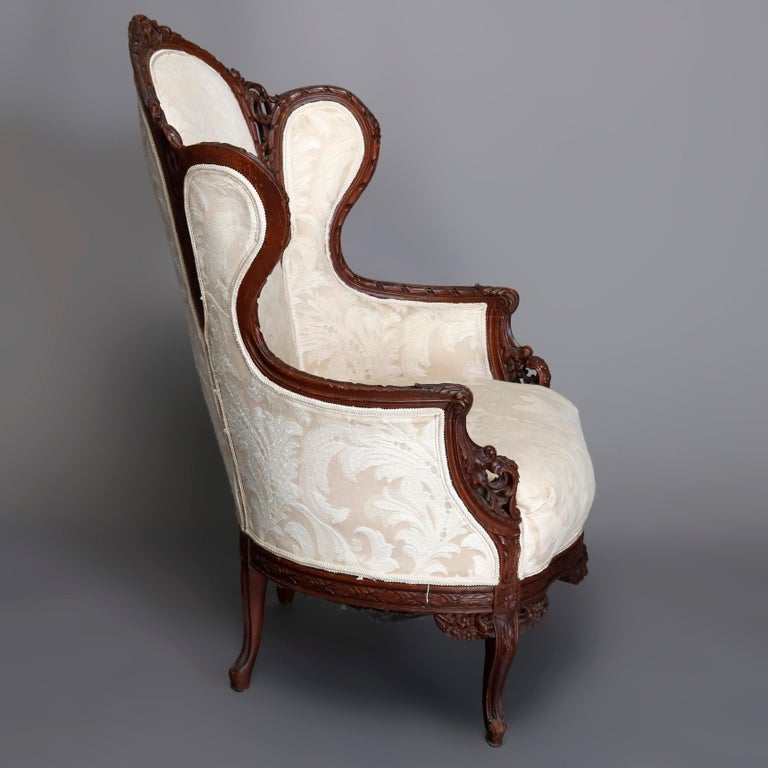 French Style Carved Mahogany Upholstered Wingback Fireside Chair, 20th Century In Good Condition For Sale In Big Flats, NY