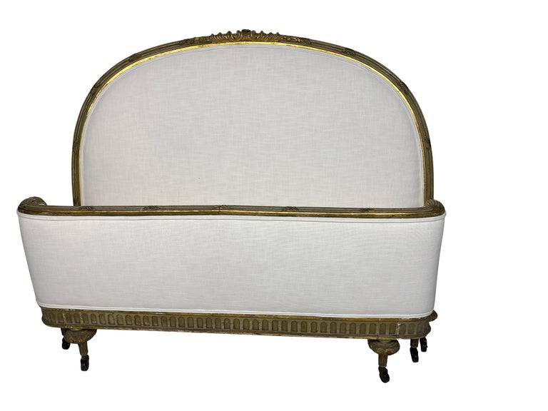French green and gilt carved bed frame to fit a full-size mattress, newly reupholstered headboard and footboard. Perfect as an elegant guest bed or child's bed. Fabric is a performance off white linen blend.