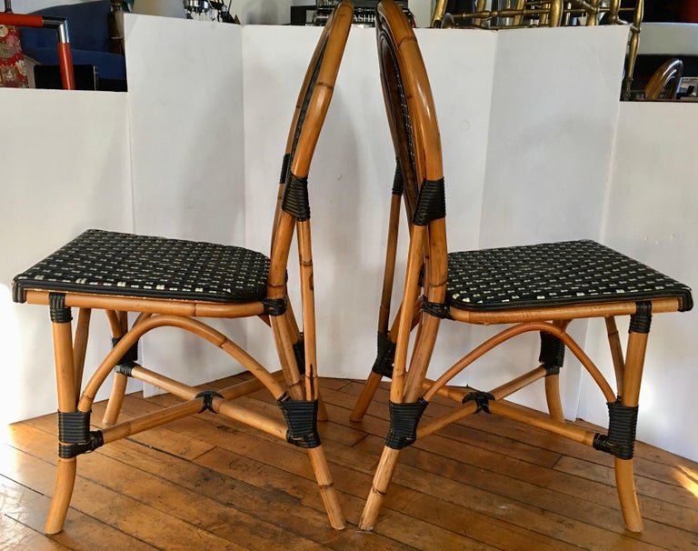 French Style Parisian Cafe Bistro Rattan Dining Chairs, Pair In Good Condition For Sale In Lambertville, NJ