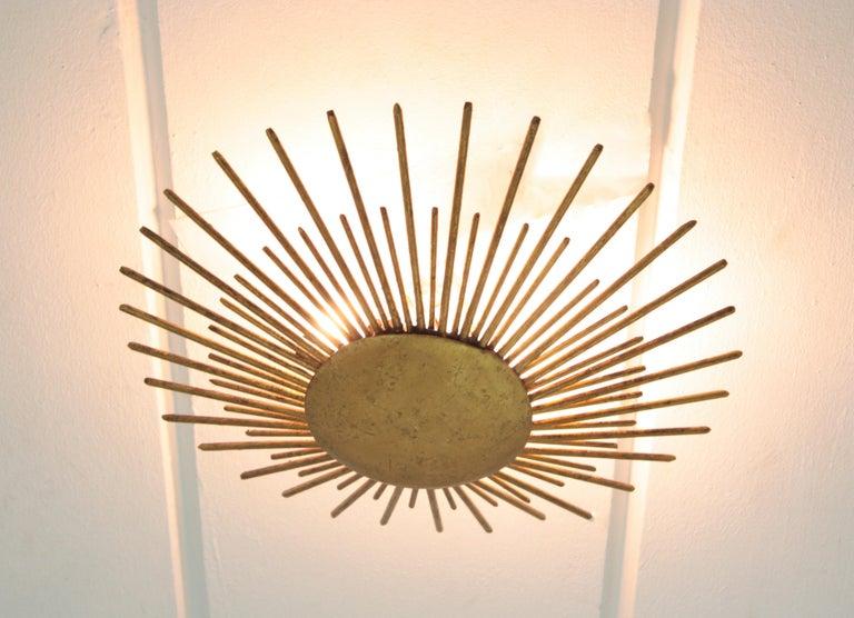 French Sunburst Light Fixture in Gilt Wrought Iron, 1940s For Sale 6