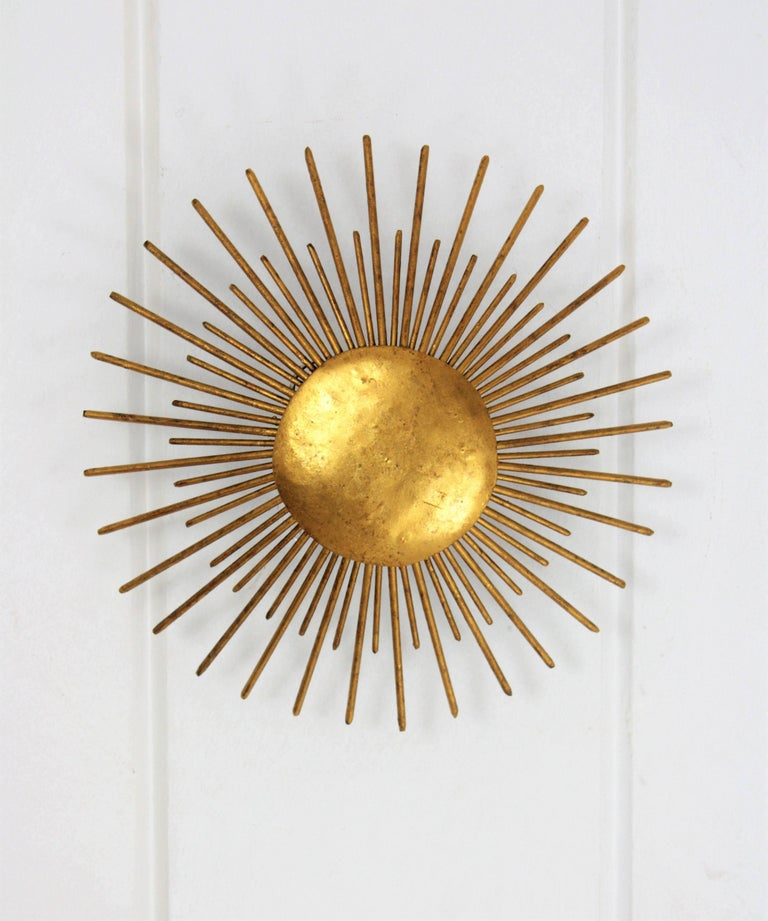 Hammered French Sunburst Light Fixture in Gilt Wrought Iron, 1940s For Sale