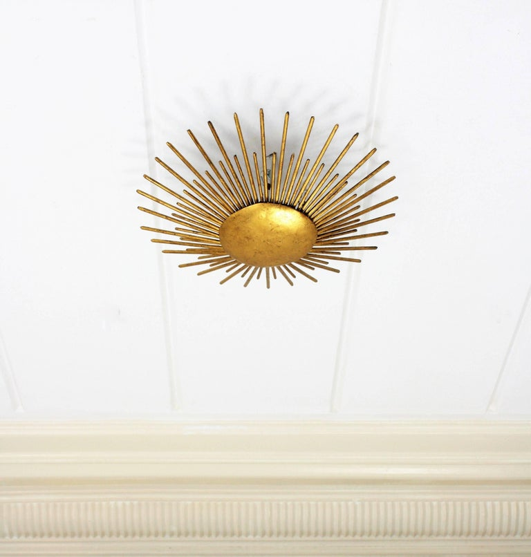 20th Century French Sunburst Light Fixture in Gilt Wrought Iron, 1940s For Sale