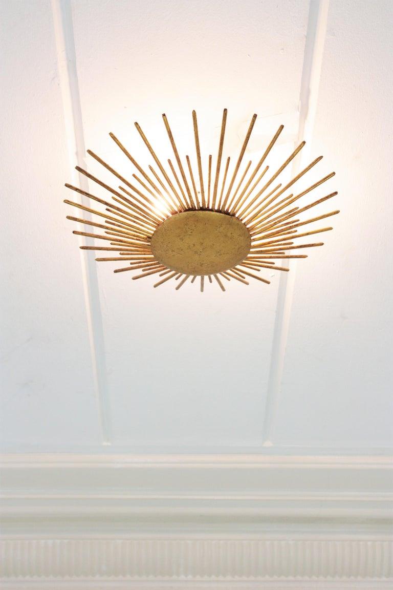 French Sunburst Light Fixture in Gilt Wrought Iron, 1940s For Sale 1