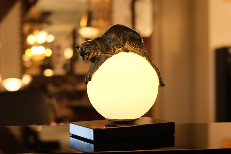 """""""Équilibré"""" (French: balanced)  Cat keeps balance on a lighted glass ball  Designed in France during the roaring 1920s by """"Gaillard"""", signed Original """"Max Le Verrier"""", stamped  Art Deco style, France.  Handmade sculpture made in """"Régule"""""""