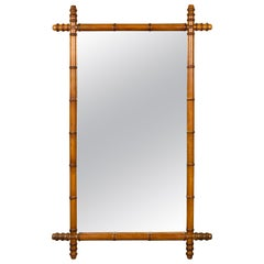 French Tall Faux Bamboo Honey Brown Mirror with Protruding Corners, circa 1920