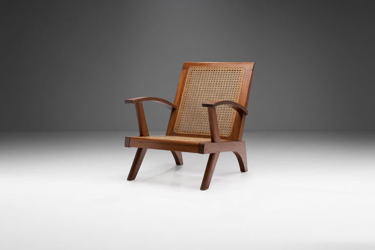 This mid-century French armchair combines a visually stunning structural body with expert caning technique and high-quality materials.   As with the UK and much of Europe, there was something of a design Renaissance in France in the 1950s, due to