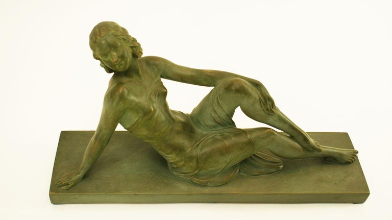 """Charming Art Deco green terracotta sculpture representing a sitting woman dressed in a beautiful outfit. There is two signature on the sculpture: one by the artist """"U Ciprianni"""" on the terrace and the second """"Terre cuite d'art"""" on the edge of the"""