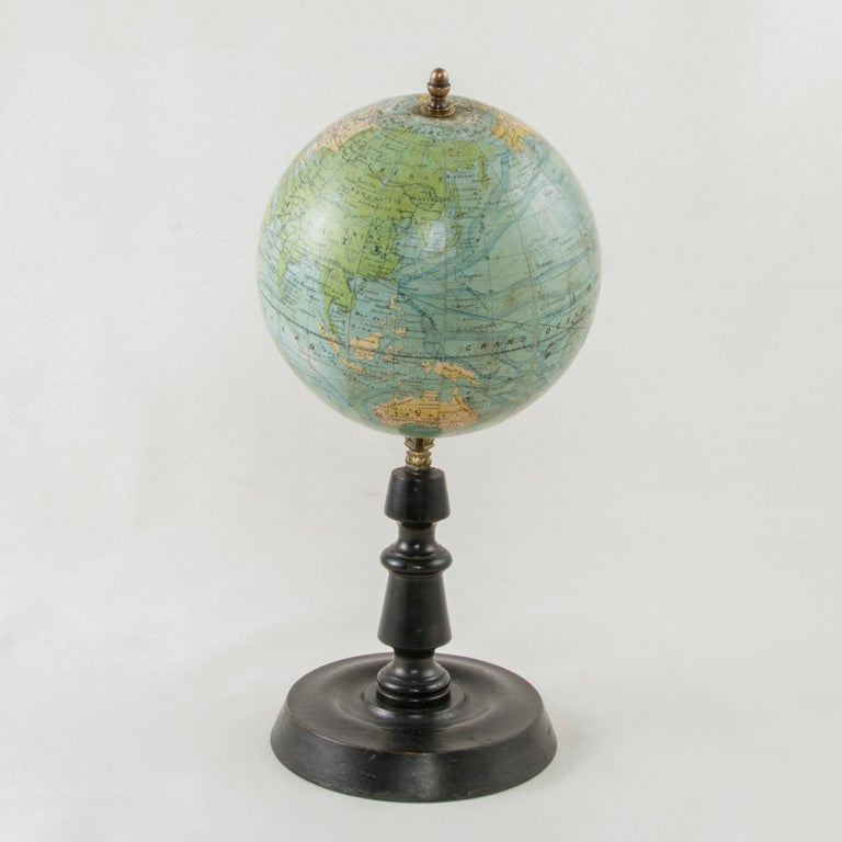This papier mâché terrestrial globe from the early 20th century was edited by the renowned French cartographer J. Forest and features not only location names, but also ocean currents and train line routes of the period. A piece of world history, the