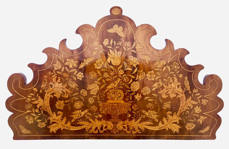 This rare French Louis XIV children's bed is attributed to Thomas Hache by well-known French leading Hache expert Marianne Clerc in 2010. The bed is comprised of a gorgeous headboard with the 1690 date inlaid at the crown. There is an equally