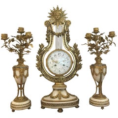 French Three-Piece Gilt Bronze Clock and Candelabrum Garniture Set, 19th Century