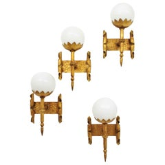 French Torch Globe Wall Lights in Wrought Gilt Iron and Milk Glass, Set of Four