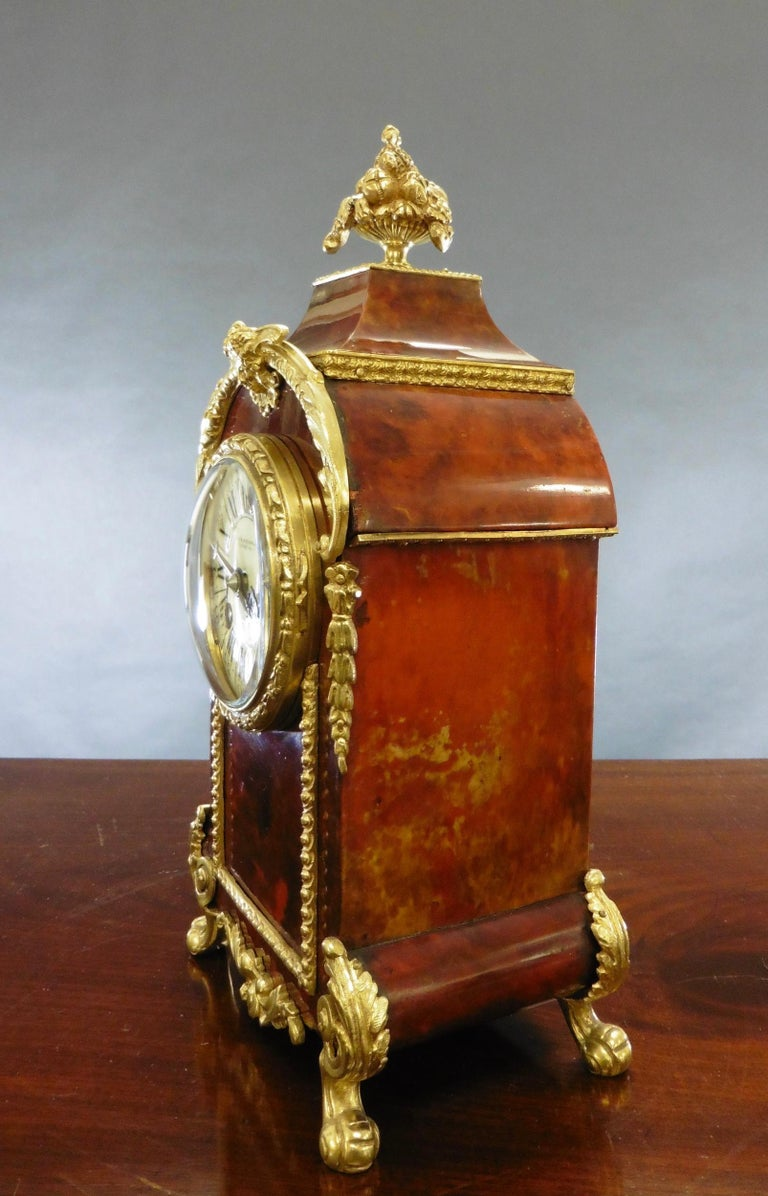 French tortoiseshell Boulle clock with ormolu mounts and surmounted by a brass finial.  Enamel dial with Roman numerals and original 'blued' steel hands signed Klaftenberger, 157 Regent Street, London.  Eight day movement numbered 44625 striking