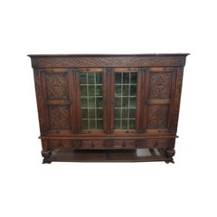 French Tudor Bookcase Cabinet 1900 Deep Hand Carving with Leaded Glass Doors