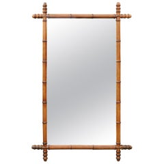 French Turn of the Century Faux Bamboo Walnut Mirror with Protruding Corners