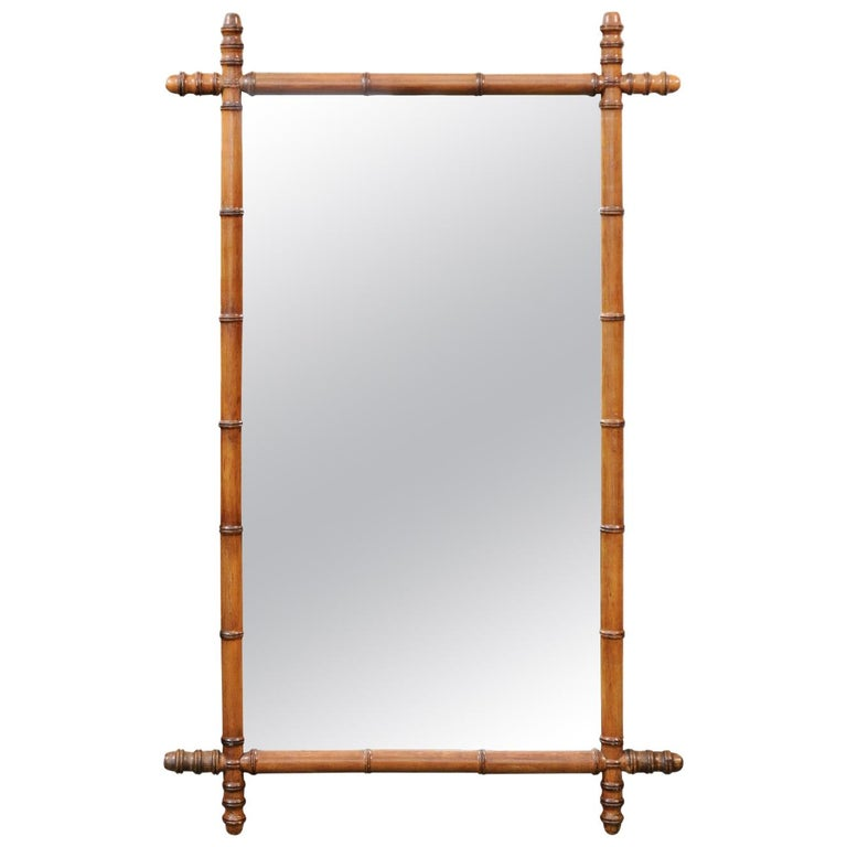 French Turn of the Century Faux Bamboo Walnut Mirror with Protruding Corners For Sale