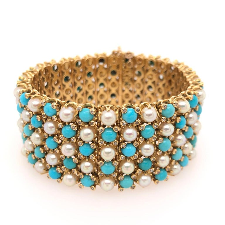 Vintage French 18 karat yellow gold gate bracelet, beautifully designed with a pattern of turquoise, pearls, and diamonds.   Size: 6 3/4 inches