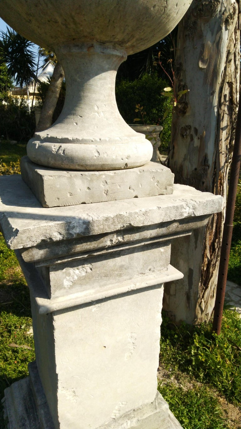 20th Century French Urns with Pedestals 'Pair' Hand-carved in Pure Limestone, antique finish. For Sale