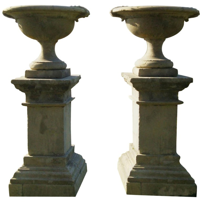 French Urns with Pedestals 'Pair' Hand-carved in Pure Limestone, antique finish. For Sale