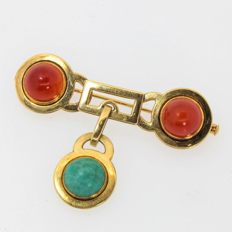 One of a kind, Mid Century French brooch created in 18KT yellow gold, featuring two cabochon cut Carnelians and one green Quartz.  The back and the pin are stamped with the French Owl hallmark, and it measures  2 1/4 inch  long by 11/16  inch high.