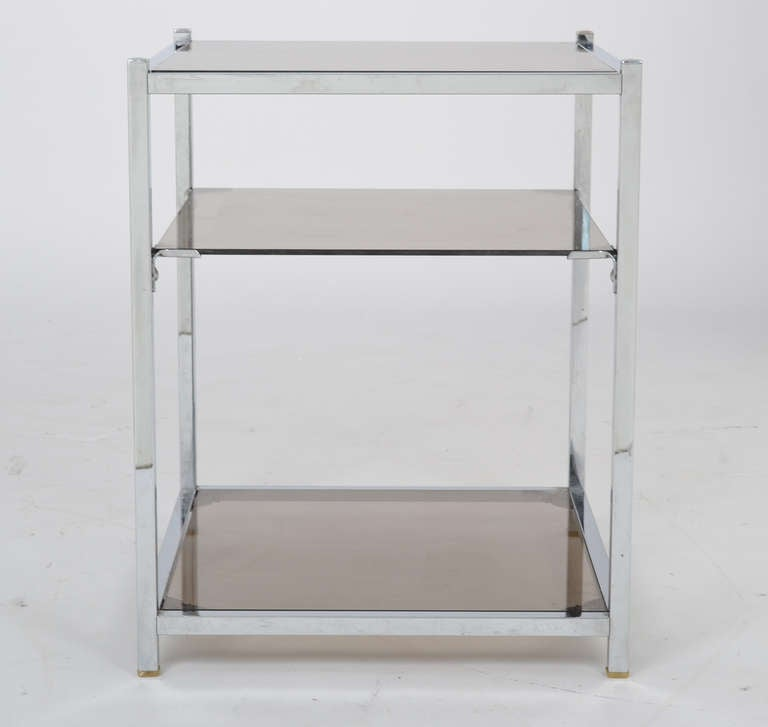 French vintage side table in chrome with three smoked glass shelves.